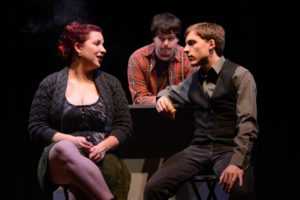"""Del Grosso (right,) Haley Smallwood (left,) and Drew Hauke (center)acting in """"Trust,"""" produced by the Theater Department in 2012."""