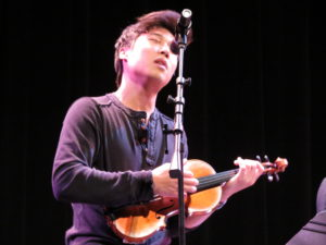"""Charles """"Charlie"""" Yang sings a verse to the group's encore performance of """"Vertigo,"""" an original love song written by a friend of the group,."""