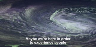 """""""Maybe we're here in order to experience people,"""" subtitles read over a swirling cloud."""